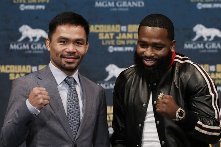 CORRECTS SPELLING TO PACQUIAO, NOT PAQUIAO AS ORIGINALLY SENT - Manny Pacquiao, left, and Adrien Broner pose for photographers at a news conference, Monday, Nov. 19, 2018, in New York. Pacquiao will defend his World Boxing Association welterweight title against Broner on Jan. 19, 2019, in Las Vegas. (AP Photo/Mark Lennihan)