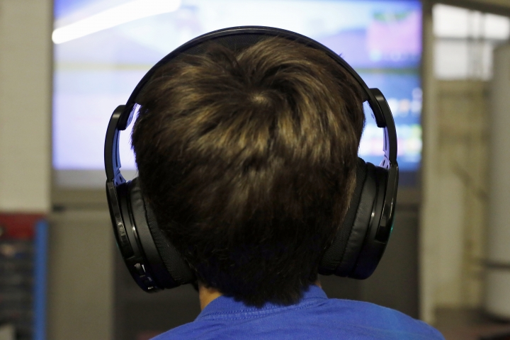 In this Saturday, Oct. 6, 2018, photo Henry Hailey, 10, plays one of the online Fortnite game in the early morning hours in the basement of his Chicago home. His parents are on a quest to limit screen time for him and his brother. The boys say they understand sometimes, but also complain that they get less screen time than their friends. (AP Photo/Martha Irvine)