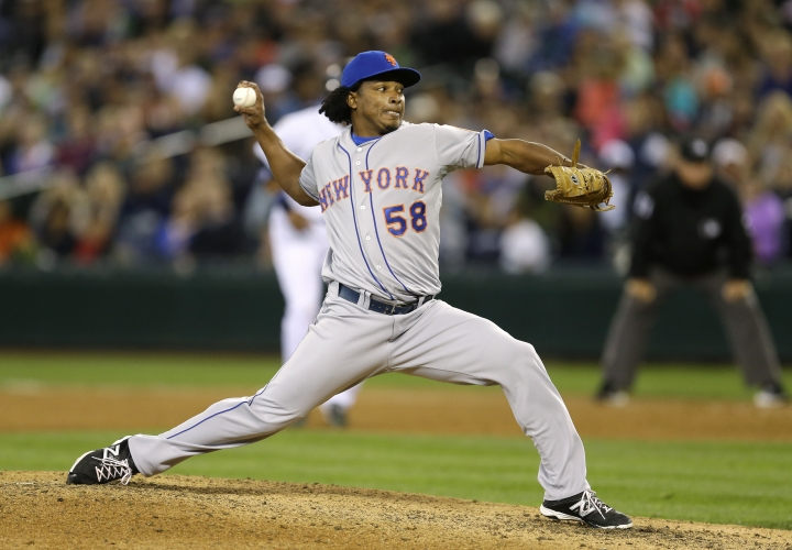 FILE - In this July 23, 2014, file photo, New York Mets closing pitcher Jenrry Mejia throws against the Seattle Mariners in the ninth inning of a baseball game in Seattle. Mejia was released by the New York Mets after serving three drug suspensions. The 29-year-old right-hander was told in July by baseball Commissioner Rob Manfred that he could return to the big leagues in 2019. Mejia was suspended for life on Feb. 12, 2016, after his third positive test for a banned steroid. The drug agreement allowed him to apply a year later for reinstatement that would be effective a minimum two years after the ban started, with the decision at the commissioner's discretion. (AP Photo/File)