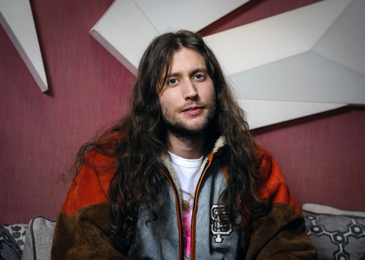 "In this Nov. 15, 2018 photo, Swedish composer Ludwig Goransson poses for a portrait in New York. At just 34, Goransson is having the best year of his career. He completed the film score for the uber-successful ""Black Panther,"" and earned three nominations at this year's Grammy Awards. He also composed music for the film ""Venom,"" released last month, and returned to the ""Creed"" franchise to do its film score. (Photo by Christopher Smith/Invision/AP)"