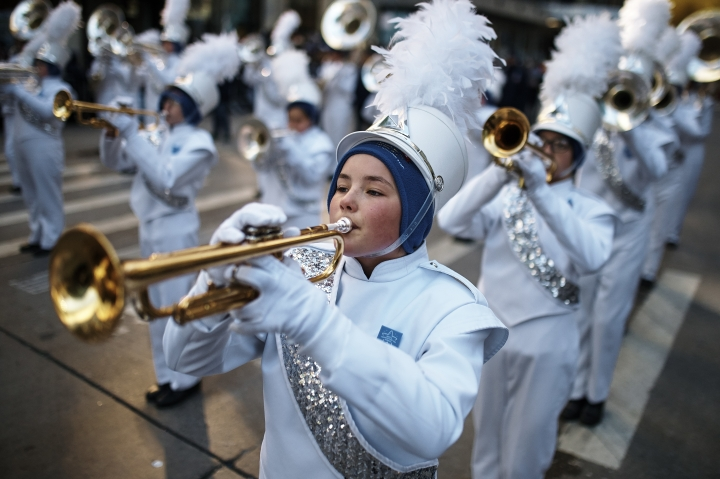 Musicians play as they move through Sixth Avenue during the 92nd annual Macy's Thanksgiving Day Parade in New York, Thursday, Nov. 22, 2018. (AP Photo/Andres Kudacki)