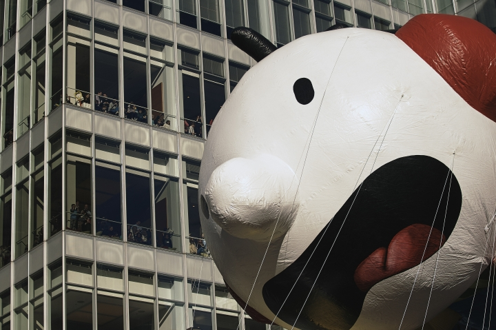 "People watch as the ""Diary of a Wimpy Kid"" series balloon moves through Sixth Avenue during the Macy's Thanksgiving Day Parade in New York, Thursday, Nov. 22, 2018. (AP Photo/Andres Kudacki)"