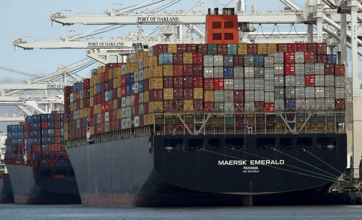 FILE - In this Thursday, July 12, 2018, file photo, the container ship Maersk Emerald is unloaded at the Port of Oakland, Calif. A U.S. government report ahead of a meeting between Presidents Donald Trump and Xi Jinping accuses China of stepping up hacking aimed at stealing American technology as a tariff dispute escalated. (AP Photo/Ben Margot, File)