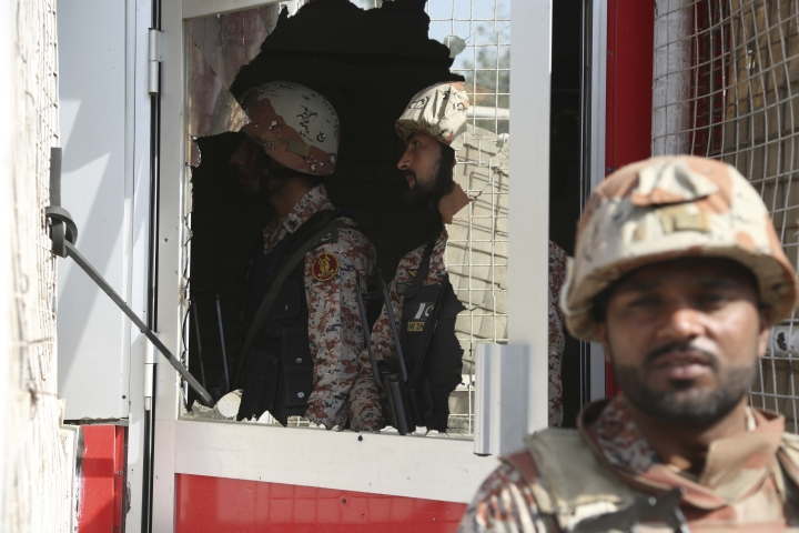 Pakistani troops move in the compound of Chinese Consulate in Karachi, Pakistan, Friday, Nov. 23, 2018. Pakistani police say gunmen have stormed the Chinese Consulate in the country's southern port city of Karachi, triggering an intense shootout. (AP Photo/Shakil Adil)