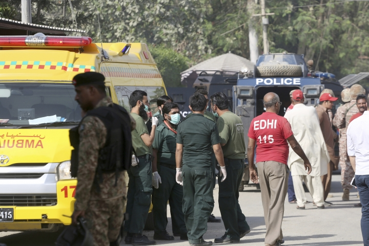 Pakistani volunteers gather outside the Chinese Consulate in Karachi, Pakistan, Friday, Nov. 23, 2018. Pakistani police say gunmen have stormed the Chinese Consulate in the country's southern port city of Karachi, triggering an intense shootout. (AP Photo/Shakil Adil)