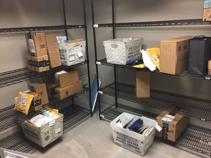 FILE - In this April 13, 2018, file photo, packages from Internet retailers are delivered with the U.S. Mail in a apartment building mail room in Washington. Shoppers going online to score after-Thanksgiving deals and begin their holiday shopping will increasingly find they're being charged sales tax at websites where they weren't before. The reason: the U.S. Supreme Court. (AP Photo/Jessica Gresko, File)
