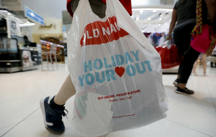 A Black Friday shopper walks through Dolphin Mall on Friday, Nov. 23, 2018, in Miami. Retailers are offering much of their Black Friday deals online, but shoppers still showed up at malls and stores around the country looking for discounts, and to take in the scene. (AP Photo/Lynne Sladky)