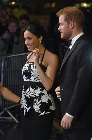 Britain's Prince Harry, right and Meghan, the Duchess of Sussex arrive to attend the Royal Variety Performance at the London Palladium in central London, Monday, Nov. 19, 2018. (John Stillwell/PA via AP)