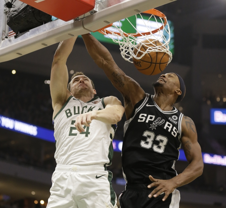 Milwaukee Bucks' Pat Connaughton (24) goes up for a dunk against San Antonio Spurs' Dante Cunningham (33) during the first half of an NBA basketball game Saturday, Nov. 24, 2018, in Milwaukee. (AP Photo/Jeffrey Phelps)