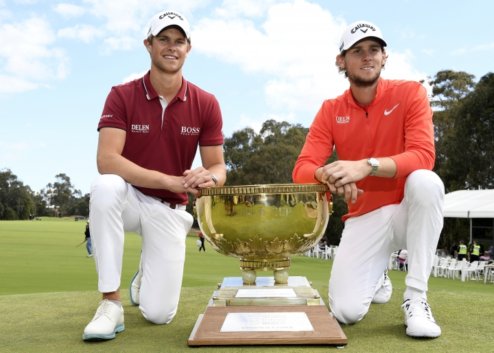 Belgium's Thomas Detry, left, and Thomas Pieters pose with the winning trophy during the World Cup of Golf in Melbourne, Australia, Sunday, Nov. 25, 2018. (AP Photo/Andy Brownbill)