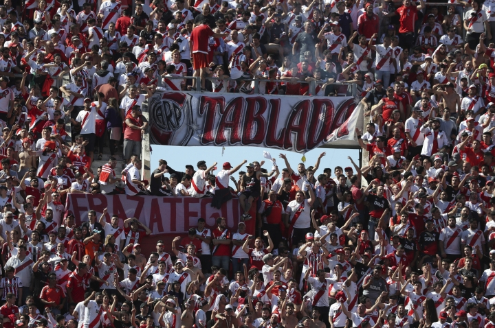 Argentina's River Plate fans cheer for their team prior the final soccer match of the Copa Libertadores against Argentina's Boca Juniors at the Antonio Vespucio Liberti stadium in Buenos Aires, Argentina, Saturday, Nov. 24, 2018. The final match of the Copa Libertadores has been pushed back after the bus carrying the Boca Juniors players was attacked by fans as it drove to the Antonio Vespucio Liberti stadium. (AP Photo/Ricardo Mazalan)