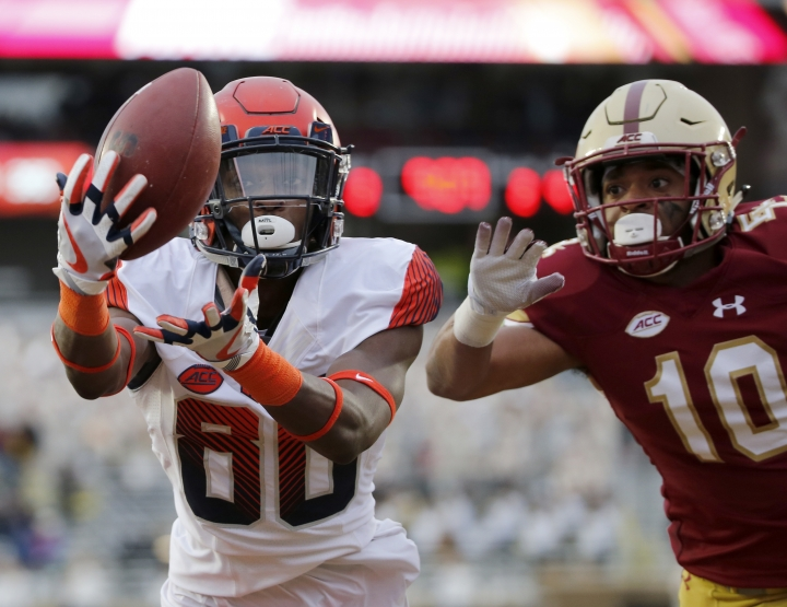 Syracuse wide receiver Taj Harris (80) catches a pass for a touchdown ahead of Boston College defensive back Brandon Sebastian (10) during the second half of an NCAA college football game, Saturday, Nov. 24, 2018, in Boston. (AP Photo/Mary Schwalm)