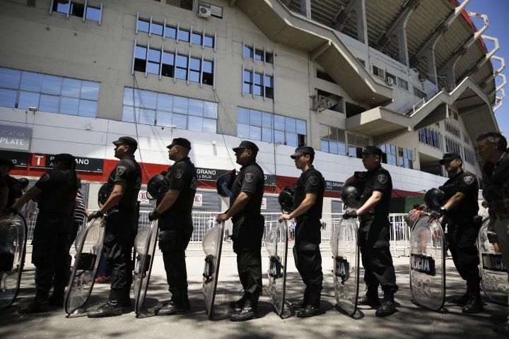 Riot police stand in line with their shields outside Antonio Vespucio Liberti stadium prior to the final Copa Libertadores match between Boca Juniors and River Plate in Buenos Aires, Argentina, Sunday, Nov. 25, 2018. (AP Photo/Ricardo Mazalan)
