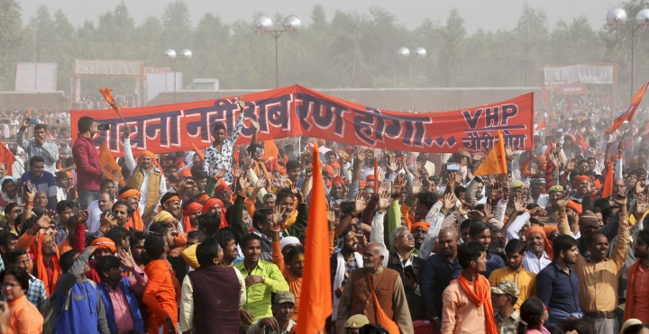 "Supporters of Vishwa Hindu Parishad or World Hindu Council gather for a rally to demand the construction of a Ram temple in Ayodhya, India, Sunday, Nov.25, 2018. Tens of thousands of Hindus gathered in the northern Indian city renewing calls to build a Hindu temple on a site where a mosque was attacked and demolished in 1992, sparking deadly Hindu-Muslim violence. Banner in Hindi reads, "" No more requests, now it will be battle""(AP Photo)"