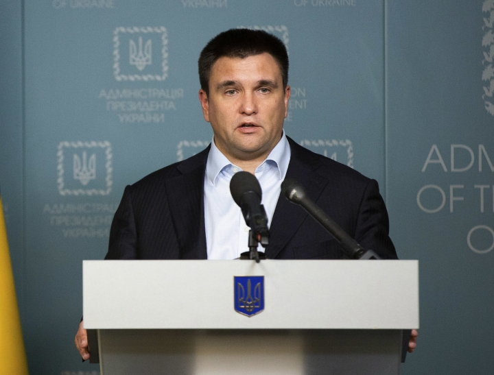 Ukrainian Foreign Affairs Minister Pavlo Klimkin speaks during his statement in Kiev, Ukraine, Sunday, Nov. 25, 2018. Russia's coast guard opened fire on and seized three of Ukraine's vessels Sunday, wounding two crew members, after a tense standoff in the Black Sea near the Crimean Peninsula, the Ukrainian navy said. (Mykhailo Markiv, Presidential Press Service via AP, Pool)