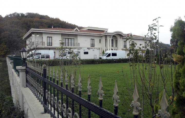 Vans are parked outside a villa during a search by Turkish police near the town of Termal, in Yalova province in northwest Turkey, Monday, Nov. 26, 2018. Turkish police, aided by sniffer dogs, searched two adjoining villas in northwest Turkey on Monday, as part of an investigation into the killing of Saudi journalist Jamal Khashoggi, officials and news reports said. (DHA via AP)