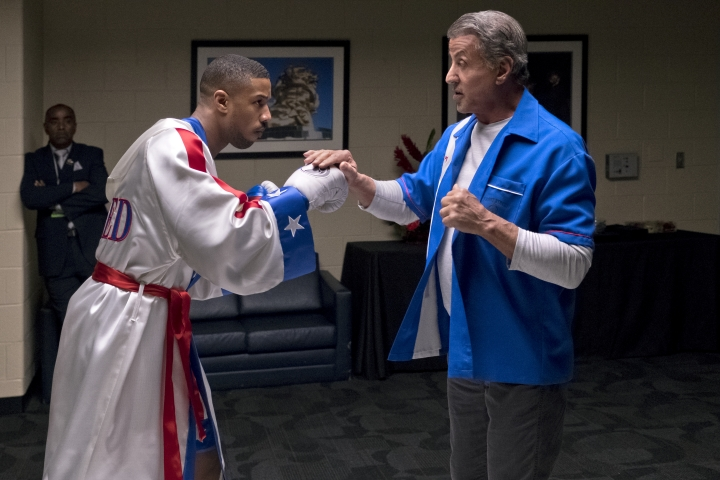 "FILE - This image released by Metro Goldwyn Mayer Pictures / Warner Bros. Pictures shows Michael B. Jordan, left, and Sylvester Stallone in a scene from ""Creed II."" The Rocky spinoff ""Creed II"" has placed second with $35.3 million from the weekend and $55.8 million since Wednesday, far surpassing the first film's Thanksgiving debut in 2015. (Barry Wetcher/Metro Goldwyn Mayer Pictures/Warner Bros. Pictures via AP, File)"
