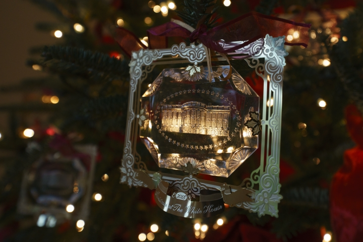 """The First Family's official Christmas ornament is seen during the press preview at the White House in Washington, Monday, Nov. 26, 2018. Christmas has arrived at the White House for 2018 as first lady Melania Trump unveiled the holiday decor. She designed the decor, which features a theme of """"American Treasures."""" (AP Photo/Carolyn Kaster)"""