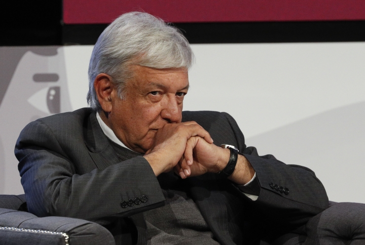 Mexican President-elect Andres Manuel Lopez Obrador listens during a meeting with Ricardo Salinas and other business leaders in Mexico City, Thursday, Nov. 22, 2018. The president-elect and Salinas signed an accord to offer internships within the Salinas Group for 12,000 young people and to create programs to assist tens of thousands of additional youth. (AP Photo/Rebecca Blackwell)