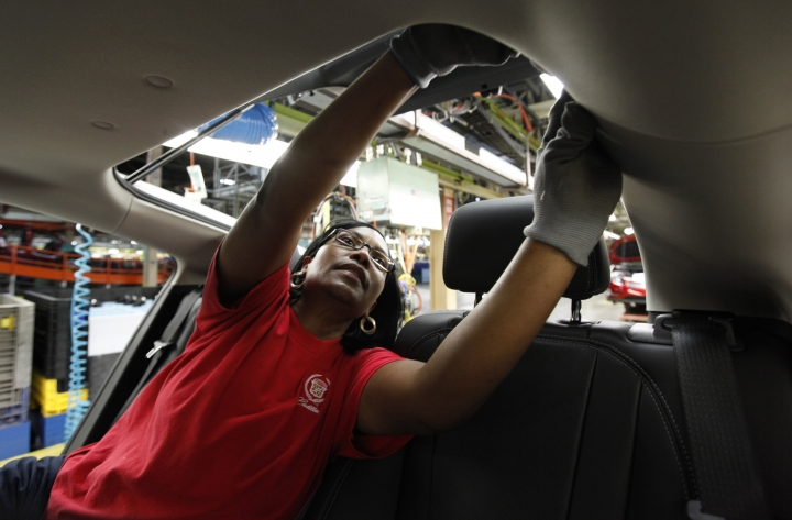 FILE- In this July 27, 2011 photo, assembly worker Julaynne Trusel works on a Chevrolet Volt at the General Motors Hamtramck Assembly plant in Hamtramck, Mich. GM announced Monday, Nov. 26, 2018, that it will lay off thousands of factory and white-collar workers in North America and put five plants up for possible closure as it restructures to cut costs and focus more on autonomous and electric vehicles. Among the possibilities are the Detroit/Hamtramck assembly plant, which makes the Buick LaCrosse, the Chevrolet Impala and Volt, and the Cadillac CT6, all slow-selling cars. (AP Photo/Paul Sancya, File)