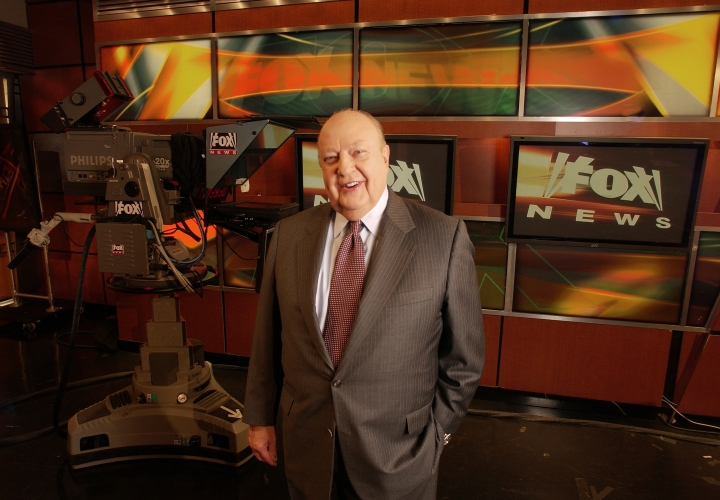 "FILE - In this Sept. 29, 2006 file photo, Fox News CEO Roger Ailes poses at Fox News in New York. A new documentary, ""Divide and Conquer: The Roger Ailes Story,"" directed by Alexis Bloom, deconstructs the rise and fall of the late head of Fox News Channel. The film opens in theaters on Dec. 6, as well as VOD, Apple iTunes, and Amazon streaming services. (AP Photo/Jim Cooper, File)"