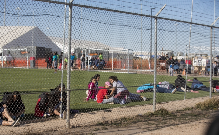 CORRECTS TO CLARIFY TEENS WERE NOT LOOKING AT PROTESTERS AS THERE WERE NOT PROTESTS THAT DAY - In this Nov. 25, 2018 photo provided by Ivan Pierre Aguirre, migrant teens held inside the Tornillo detention camp sit inside the facility in Tornillo, Texas. The Trump administration announced in June 2018 that it would open the temporary shelter for up to 360 migrant children in this isolated corner of the Texas desert. Less than six months later, the facility has expanded into a detention camp holding thousands of teenagers - and it shows every sign of becoming more permanent. (Ivan Pierre Aguirre via AP)