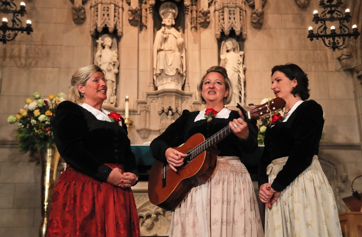 "The Kroell Family Singers, Gerlinde, left, Elisabeth, center, and Christiane, sing Christmas Carols during a celebration of the song ""Silent Night,"" at Trinity Church, Tuesday, Nov. 27, 2018, in New York. ""Silent Night,"" one of the most famous songs of the Christmas season, is being celebrated as it approaches its 200th anniversary. Written and sung in Austria in December 1818, the song was first performed in the U.S. in 1839 at the Hamilton Memorial on the church's grounds by an Austrian family of traveling singers. (AP Photo/Julie Jacobson)"