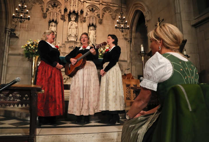 """The Kroell Family Singers, Gerlinde, left, Elisabeth, center, and Christiane, sing Christmas Carols during a celebration of the song """"Silent Night,"""" at Trinity Church, Tuesday, Nov. 27, 2018, in New York. """"Silent Night,"""" one of the most famous songs of the Christmas season, is being celebrated as it approaches its 200th anniversary. Written and sung in Austria in December 1818, the song was first performed in the U.S. in 1839 at the Hamilton Memorial on the church's grounds by an Austrian family of traveling singers. (AP Photo/Julie Jacobson)"""
