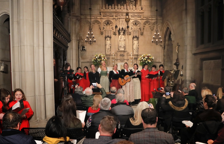 """The Kroell Family Singers, center, sing """"Silent Night"""" with the Choir of Trinity Wall Street and Trinity Youth Chorus during a celebration of the anniversary of the song at Trinity Church, Tuesday, Nov. 27, 2018, in New York. """"Silent Night,"""" one of the most famous songs of the Christmas season, is being celebrated as it approaches its 200th anniversary. Written and sung in Austria in December 1818, the song was first performed in the U.S. in 1839 at the Hamilton Memorial on the church's grounds by an Austrian family of traveling singers. (AP Photo/Julie Jacobson)"""
