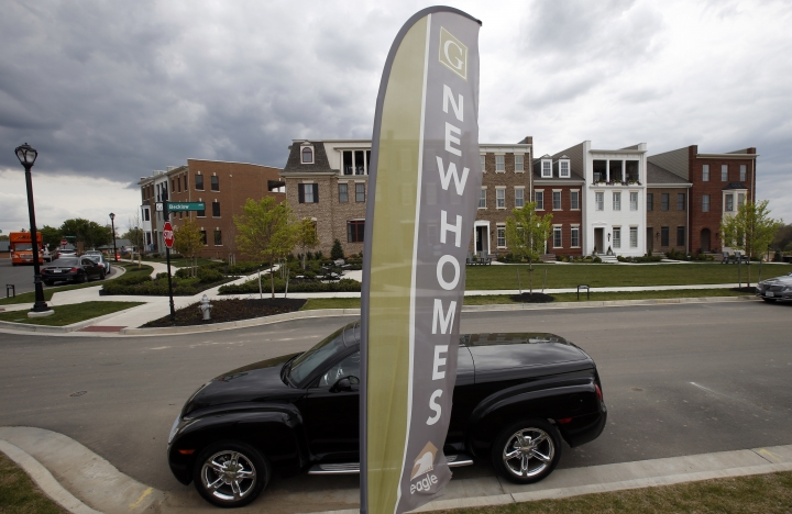 FILE- In this April 23, 2018, file photo advertising signs point out completed new homes, homes under construction as well as lots for new homes in Glen Allen, Va. On Wednesday, Nov. 28, the Commerce Department reports on sales of new homes in October. (AP Photo/Steve Helber, File)