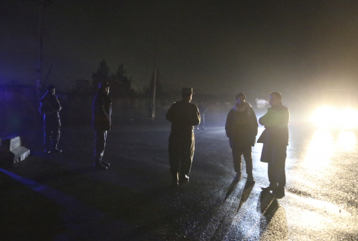 Security forces block a road at the site of a suicide bomb attack in Kabul, Afghanistan, Wednesday, Nov. 28, 2018. Najib Danish, spokesman for Afghanistan's Interior Ministry, said the attack in Kabul took place when a suicide bomber detonated his explosives and then other insurgents started a gun battle with forces in the area. (AP Photo/Rahmat Gul)