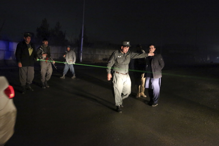 Security forces block the roads at the site of a suicide bomber attack in Kabul, Afghanistan, Wednesday, Nov. 28, 2018. Najib Danish, spokesman for Afghanistan's Interior Ministry, said the attack in Kabul took place when a suicide bomber detonated his explosives and then other insurgents started a gun battle with forces in the area. (AP Photo/Rahmat Gul)