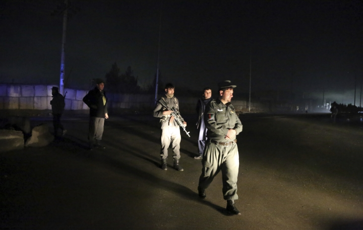 Security forces block the roads at the site of a suicide bomb attack in Kabul, Afghanistan, Wednesday, Nov. 28, 2018. Najib Danish, spokesman for Afghanistan's Interior Ministry, said the attack in Kabul took place when a suicide bomber detonated his explosives and then other insurgents started a gun battle with forces in the area. (AP Photo/Rahmat Gul)