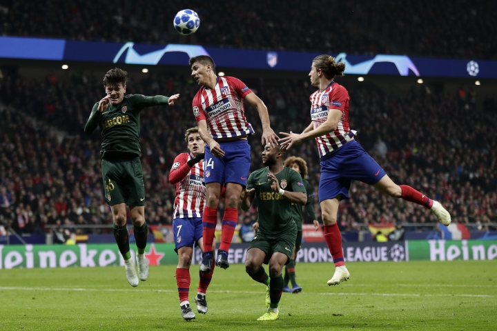 Atletico midfielder Rodrigo Hernandez, center, heads the ball during a Group A Champions League soccer match between Atletico Madrid and Monaco at the Metropolitano stadium in Madrid, Wednesday, Nov. 28, 2018. (AP Photo/Manu Fernandez)