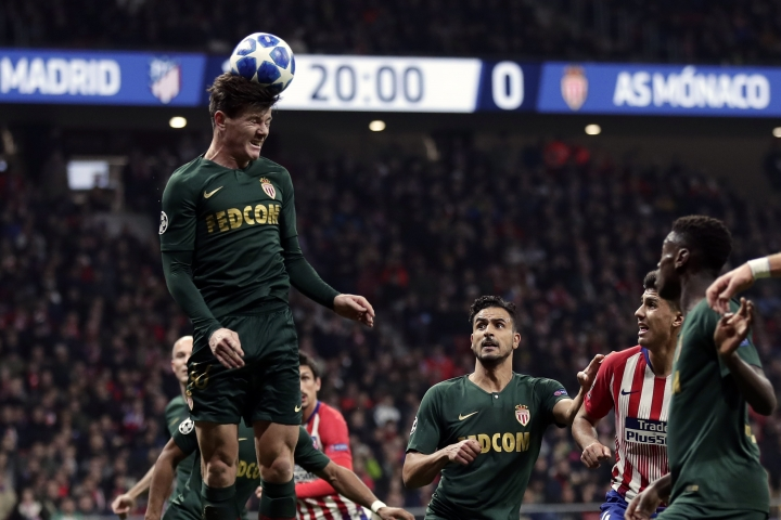 Monaco's Giulian Biancone heads the ball during a Group A Champions League soccer match between Atletico Madrid and Monaco at the Metropolitano stadium in Madrid, Wednesday, Nov. 28, 2018. (AP Photo/Manu Fernandez)