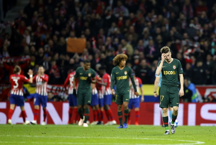 Monaco's Aleksandr Golovin, right, reacts after Atletico Madrid's Antoine Griezmann scores his side's second goal during a Group A Champions League soccer match between Atletico Madrid and Monaco at the Metropolitano stadium in Madrid, Wednesday, Nov. 28, 2018. (AP Photo/Paul White)