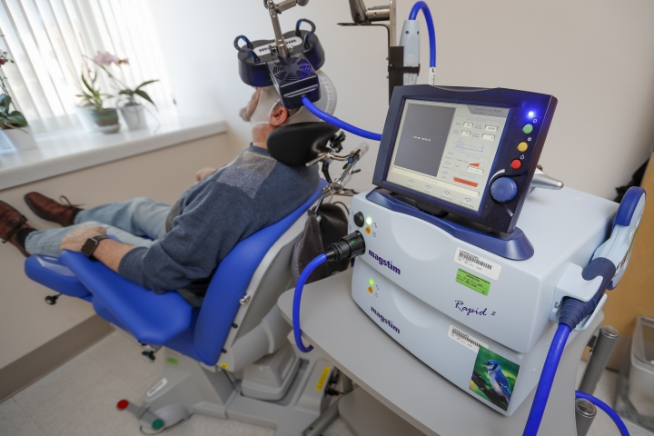 A patient receives a transcranial magnetic stimulation treatment at the VA Palo Alto Health Care System on Wednesday, Nov. 7, 2018, Palo Alto, Calif. The device, which uses magnetic fields to stimulate the brain, is being used on military veterans suffering from depression. (AP Photo/Tony Avelar)