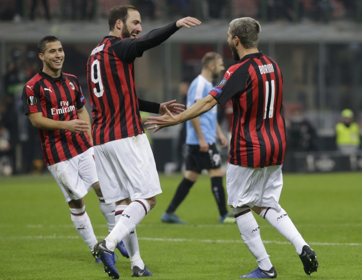 AC Milan's Fabio Borini, right, celebrates with teammate Gonzalo Higuain after scoring his team's fifth goal during the Europa League soccer match between AC Milan and F-91 Dudelange at the San Siro Stadium, in Milan, Italy, Thursday, Nov. 29, 2018. (AP Photo/Luca Bruno)