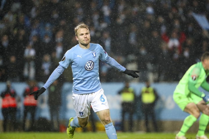 Malmo's Oscar Lewicki celebrates bringing the score to 1-2 against Genk, during their UEFA Europa League group I soccer match, Malmo FF vs KRC Genk, at Malmo New Stadium in Malmo, Sweden, Thursday Nov. 29, 2019. (Andreas Hillergren / TT via AP)