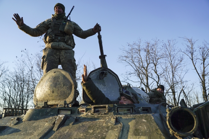 Ukrainian soldiers stand atop an APC near Urzuf, south coast of Azov sea, eastern Ukraine, Thursday, Nov. 29, 2018. Ukraine put its military forces on high combat alert and announced martial law this week after Russian border guards fired on and seized three Ukrainian ships in the Black Sea. (AP Photo/Evgeniy Maloletka)