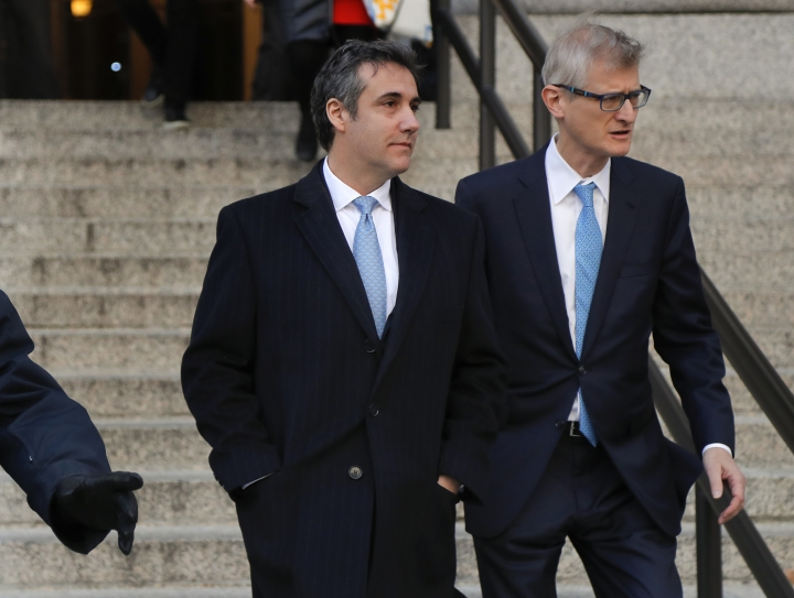 "Michael Cohen, left, walks out of federal court with his attorney Guy Petrillo, Thursday, Nov. 29, 2018, in New York, after pleading guilty to lying to Congress about work he did on an aborted project to build a Trump Tower in Russia. Cohen, President Donald Trumps former lawyer, told the judge he lied about the timing of the negotiations and other details to be consistent with Trump's ""political message."" (AP Photo/Julie Jacobson)"