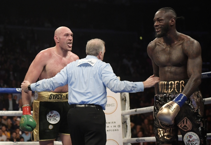 Tyson Fury, left, of England, taunts Deontay Wilder during a WBC heavyweight title boxing match Saturday, Dec. 1, 2018, in Los Angeles. (AP Photo/Mark J. Terrill)