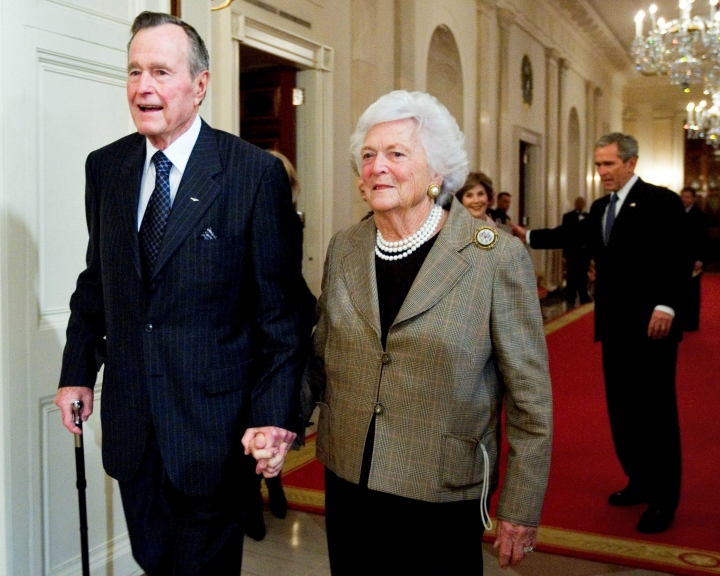 FILE - In this Jan. 7, 2009, file photo, former President George H.W. Bush, left, walks with his wife, Barbara Bush, followed by their son, President George W. Bush, and first lady Laura Bush to a reception in honor of the Points of Light Institute in the East Room at the White House in Washington. Bush has died at age 94. Family spokesman Jim McGrath says Bush died shortly after 10 p.m. Friday, Nov. 30, 2018, about eight months after the death of his wife, Barbara Bush. (AP Photo/Manuel Balce Ceneta, File)