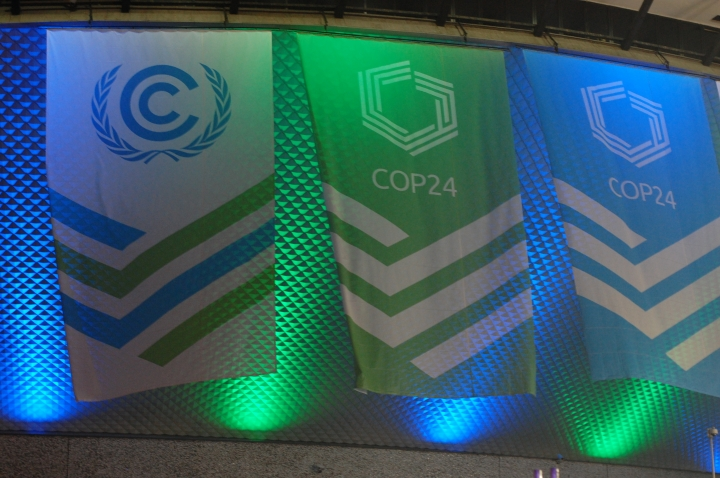 This Dec. 1, 2018 photo flags hang outside of the venue for the COP24 global climate talks in Katowice, Poland. Negotiators from around the world are meeting in Poland for talks on curbing climate change. (AP Photo/Frank Jordans)