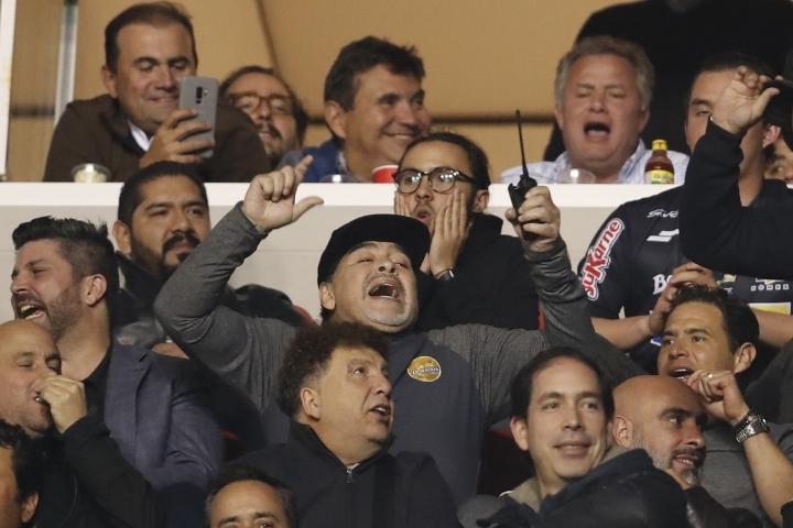 Dorados head coach Diego Maradona, center, celebrates the second goal of his team against Atletico San Luis during the final leg of Mexico's second division soccer league in San Luis Potosi, Mexico, Sunday, Dec. 2, 2018. Maradona was sent off the field during the first leg of the final after receiving a red card. (AP Photo/Eduardo Verdugo)