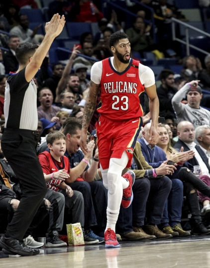 New Orleans Pelicans forward Anthony Davis (23) heads up the court after making a three-point basket against the Dallas Mavericks in the second half of an NBA basketball game in New Orleans, Wednesday, Dec. 5, 2018. The Pelicans won 132-106. (AP Photo/Scott Threlkeld)