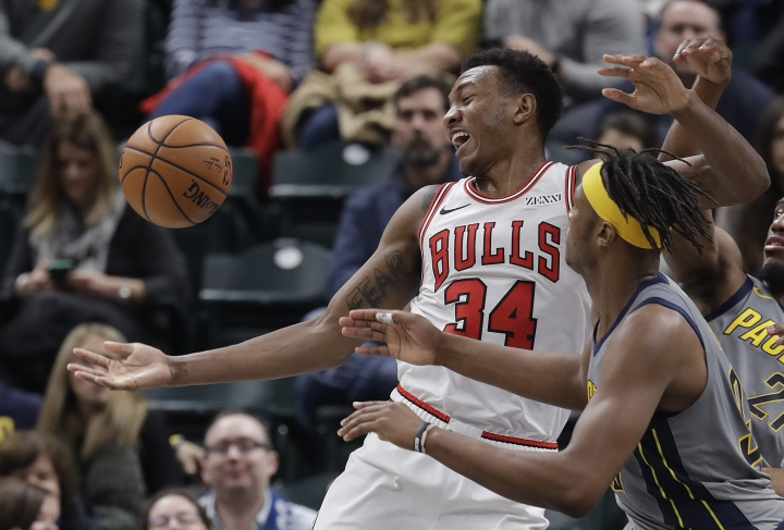 Chicago Bulls' Wendell Carter Jr. (34) grabs a rebound against Indiana Pacers' Myles Turner during the second half of an NBA basketball game, Tuesday, Dec. 4, 2018, in Indianapolis. Indiana won 96-90. (AP Photo/Darron Cummings)