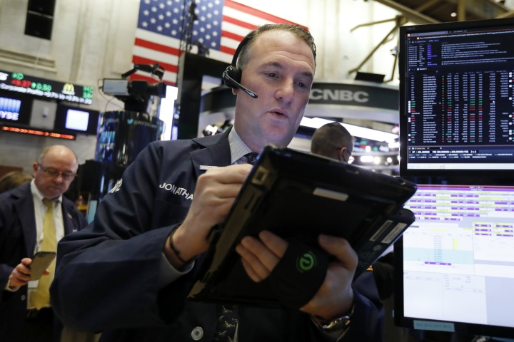 FILE- In this Nov. 28, 2018, file photo trader Jonathan Corpina works on the floor of the New York Stock Exchange. The U.S. stock market opens at 9:30 a.m. EST on Thursday, Dec. 6. (AP Photo/Richard Drew, File)