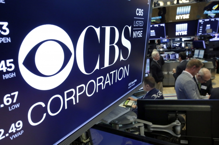 FILE - In this July 30, 2018, photo the logo for CBS Corporation is displayed above a trading post on the floor of the New York Stock Exchange. CBS says it has sold Television City, its Los Angeles headquarters and production facility, to a real estate developer for about $750 million. (AP Photo/Richard Drew, File)