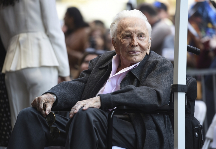 FILE - In this Nov. 6, 2018 file photo, actor Kirk Douglas attends a ceremony honoring his son actor Michael Douglas with a star on the Hollywood Walk of Fame in Los Angeles. Public officials and relatives of Douglas have unveiled a new historic marker in his upstate New York birthplace to honor the Hollywood legend on his birthday. The blue and yellow New York state historic marker was presented in Amsterdam on Sunday, the actor's 102nd birthday. The sign will be erected near the home where he was born as Issur Danielovitch to Russian Jewish parents on Dec. 9, 1916. (Photo by Chris Pizzello/Invision/AP, File)